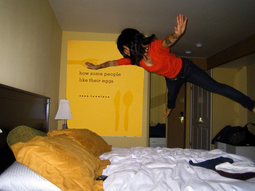 jumping nude on bed
